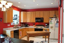 what color to paint kitchen cabinets with red walls cherry wood