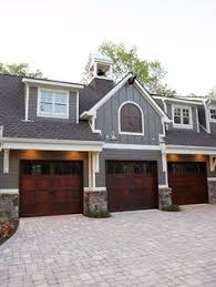 how big is a three car garage rustic 3 car garage with half rounded windows above the average