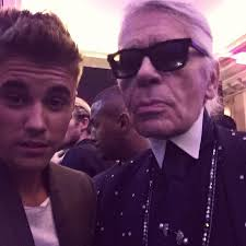 justin bieber hits up fashion week poses with karl lagerfeld