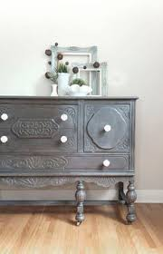 a driftwood buffet makeover with white knobs chalk paint