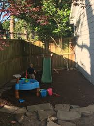backyard play space for kids used rubber mulch in a area that was