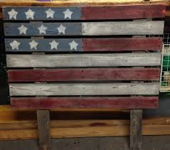 an american flag yard decoration made out of pallets a lil