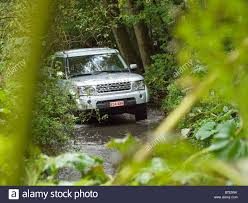 silver land rover discovery silver land rover discovery 4 driving through a creek at the