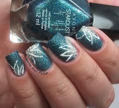 the clockwise nail polish avon teal glitter u0026 flower nail art