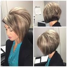 stacked bob haircut with blonde highlights on dark hair hair