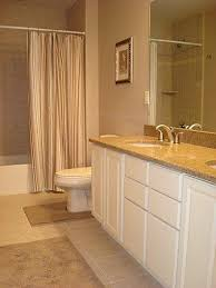 Bathroom With White Cabinets - cabinets with beige granite