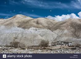 Landscape With Houses by Barren Mountain Landscape With Houses In Lo Manthang Kingdom Of