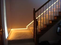 indoor stair designed with wooden railing and lighting