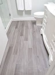 love the wood look tile urban farmhouse master bathroom remodel