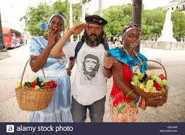 local cuban people dressed up and posing for tourists havana