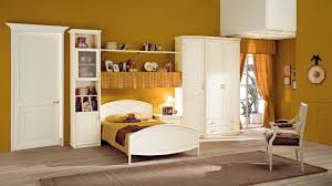 paint for kids room classic wooden wardrobe designs with wall shelving and yellow wall
