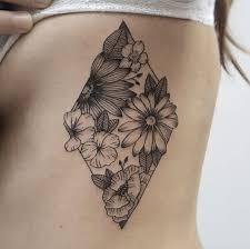 floral filled on rib cage by barcelona