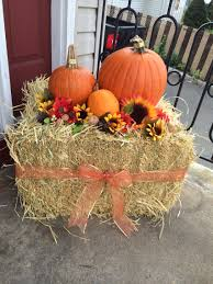 fall front porch decor with hay bales and pumpkins halloween and