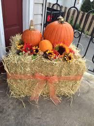 our fall front porch decorations haystack pumpkins