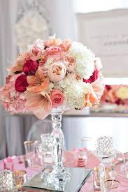 fabulous peach and pink wedding centerpiece on a mirrored pedestal