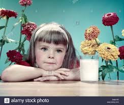 1950s headband 1950s thoughtful girl bangs white headband leaning arms