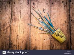 used paint brushes scattered a rustic wooden background stock