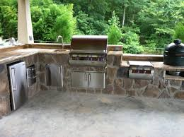 this is a custom outdoor kitchen with a built in fire magic grill