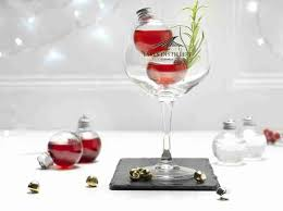 wine glass christmas ornaments chistmas ornaments filled with booze whisky vodka gin thrillist