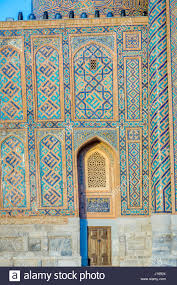 mosaic of blue tiles patterns on the wall of samarkand registan