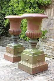 large terracotta urns on plinths urns planters inside terracotta