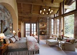 Rustic Master Retreat With Fireplace And A Lot Of Windows - Country bedroom designs