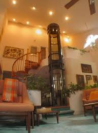 homes with elevators pneumatic elevators becoming popular for residential use