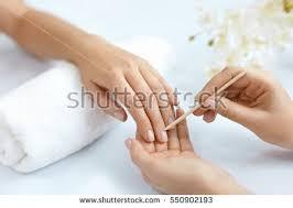 nail care manicure closeup beautiful female stock photo 550897651
