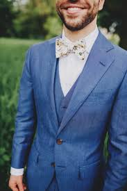 floral bowtie chambray blue suit white floral bowtie wedding inspiration board