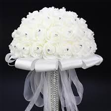 wedding flowers orchids white holding bouquet artificial white ribbon handle