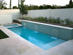 long skinny home pool design with minimalist three wall waterfalls