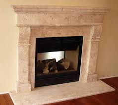 stacked stone fireplace surround with marble mantle as well as