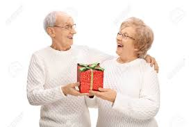 elderly gifts cheerful elderly exchanging gifts isolated on white