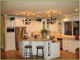 kitchen kitchen island with sink and dishwasher hanging pendant