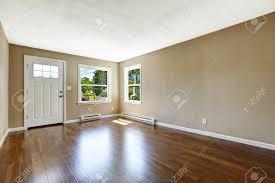 empty house interior hardwood floor and beige walls white