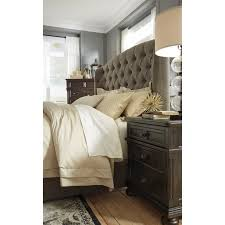 king upholstered bed with arched tufted headboard and low