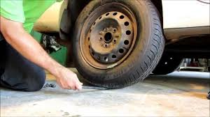 how to change your flat tire toyota camry le youtube