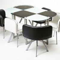 furniture round brown wooden space saving table and four chairs