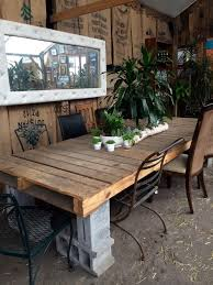big shipping pallet and concrete block outdoor table improvised life