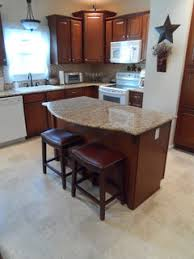 kitchen cabinets on top of floating floor installing laminate flooring kitchen cabinets yes or no