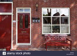 brick house front door red brick house front with red bench and red front door edam the