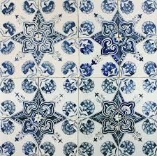 antique delft wall tiles in blue with dianthus flower