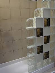 colored and frosted glass block shower wall with step down blocks