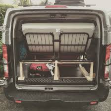 peugeot traveller camper pragmabed adjustable full size bed installed in a ford transit