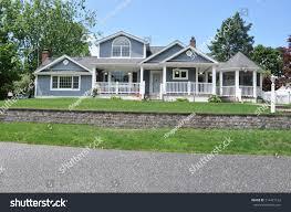 beautiful suburban craftsman cottage style home stock photo