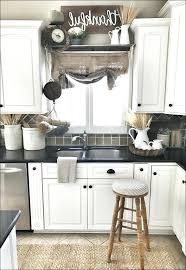 ideas for tops of kitchen cabinets decorating ideas for above kitchen cabinets eventsbygoldman com