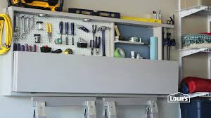 home tips create a customized storage space with lowes garage above garage door storage lowes lowes garage storage laundry room shelves