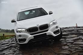 new bmw x6 goes off road in the rain