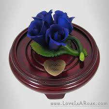 porcelain roses four blue capodimonte porcelain roses on leaves is a