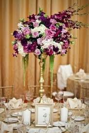 wow various hues of purple in this tall centerpiece are so regal